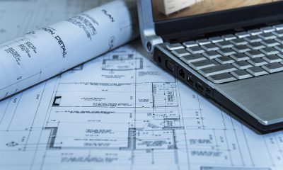Architectural plans and laptop